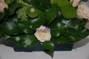Arranjo floral com rosas Stª Teresinha
